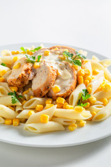 Yummy pasta with chicken, corn and bechamel sauce
