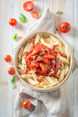 Delicious penne bolognese made of fresh tomatoes