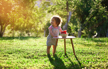 Smiling baby girl eating watermelon. Fruit, Childhood, healthy eating, nature, play