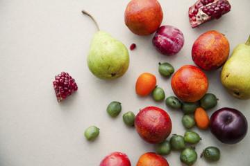 Varitety of fresh summer fruits on neutral background