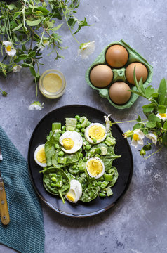 Baby spinach, celery and pea salad with egg dressing