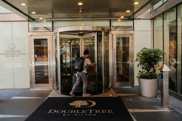 A man goes inside 569 Lexington Avenue building, a location cited in the criminal complaint against film producer Weinstein, in New York