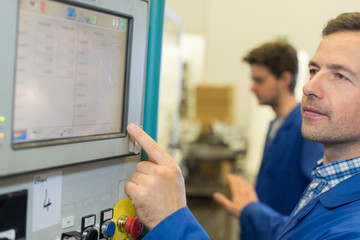 Engineer using touchscreen controls