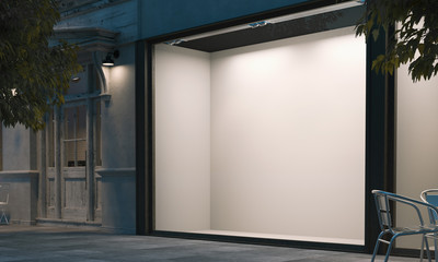 Blank shop window in the night street with light on the frame. 3d rendering