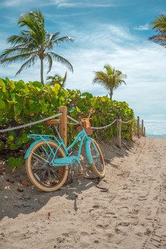 Blue, urban, stylish bike on Miami Beach, Florida. Bicycle adventure trip tour outdoors background. Sandy beach trail