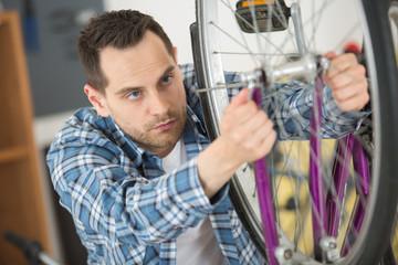 man bicycle mechanic repairing bicycles