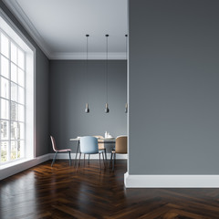 Gray dining room interior, pastel chairs, wall