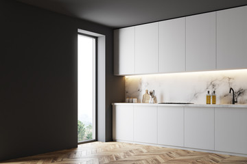 White and black counterops in kitchen side view