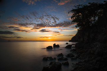 Rocky Island Beach With Silky Smooth Sea - Philippines