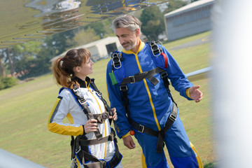 couple about to jump in parachutes