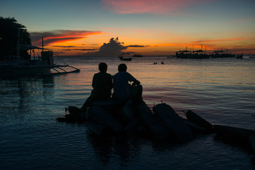 Two Traveler Silhouettes During Romantic Island Sunset