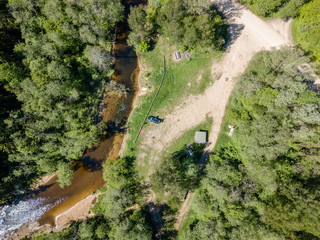drone image. aerial view of rural area with river in forest
