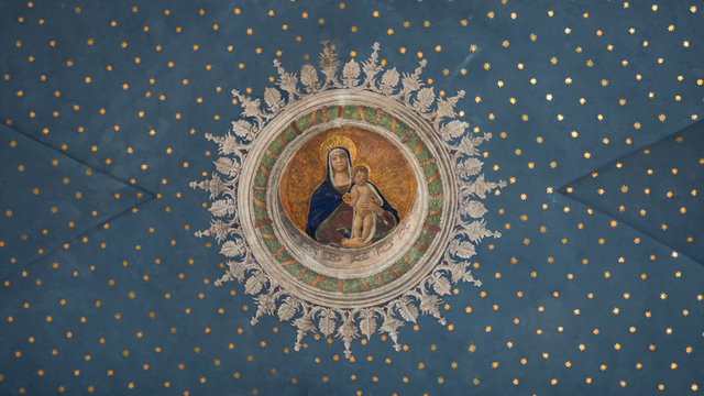 Virgin Mary with child Jesus painted on the starry ceiling inside the Gothic-Renaissance cathedral.