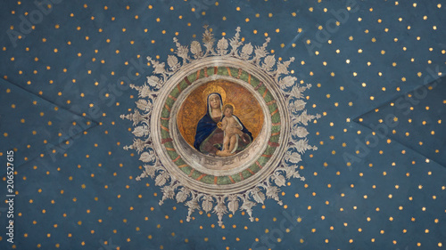 Fototapete Virgin Mary with child Jesus painted on the starry ceiling inside the Gothic-Renaissance cathedral.