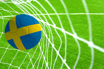 3d rendering of a soccer ball with the flag of Sweden in the net.