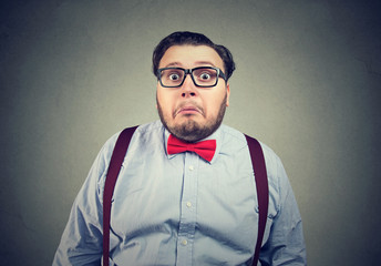 Confused chunky man in bow tie
