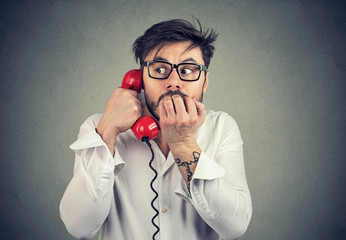 Stressed man speaking on phone