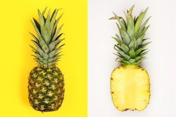 Creative pineapple layout. Whole fruit on bright yellow, half slice with white background. Minimal summer concept Top view.
