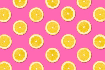 Colorful fruit pattern, Lemon slices on a pastel pink background. Top view.