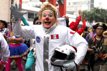Clown takes part in a parade during Peru's Clown Day celebrations in Lima
