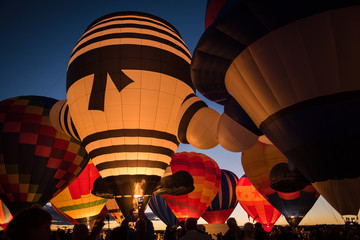 Hot air balloon lit up against the night sky in Albuquerque, New Mexico.