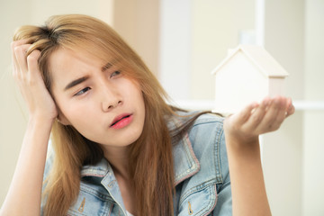 Young woman planning to buy a house.