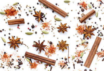 background of various spices on a white background