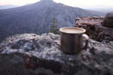 coffee in a metal mug in nature