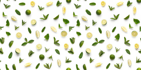 Food texture. Seamless pattern of fresh fruits isolated on white background, top view, flat lay. slices lemons, lime and mint.