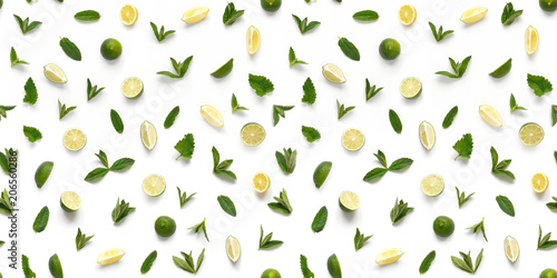 Fototapete Food texture. Seamless pattern of fresh fruits isolated on white background, top view, flat lay. slices lemons, lime and mint.