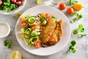 Vegetable salad and schnitzel