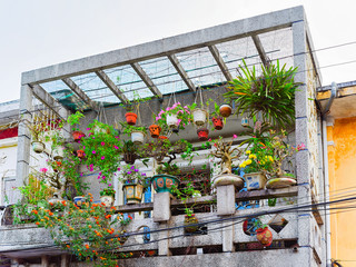 Balcony with flowers in building in Hoi An