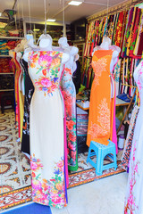 Silk dresses and clothes on street market in Hanoi