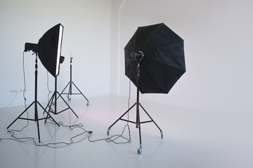 An empty photo Studio with  white cyclorama, photo equipment is ready to shoot.