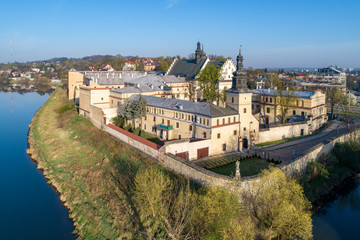 Krakow, Poland. Salwator district with Norbertine nunnery, church, Vistula and Rudawa rivers and far view of Kosciuszko Mound. Aerial photo in sunrise light