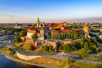 Aluminium Prints Castle Poland. Krakow skyline with Wawel Hill, Cathedral, Royal Wawel Castle, defensive walls,Vistula riverbank, park, promenade, walking people. Old city in the background