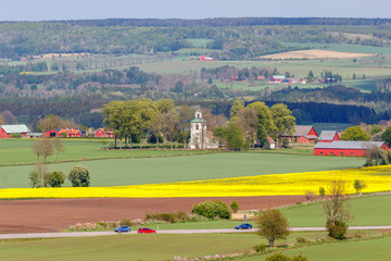 Rural landscape view with a church and car traffic