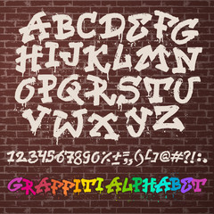 Alphabet graffiti vector alphabetical font ABC by brush stroke graffity font with letters and numbers or grunge alphabetic typography illustration isolated on brick wall background