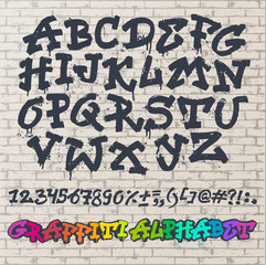 Alphabet graffity vector alphabetical font ABC by brush stroke with letters and numbers or grunge alphabetic typography illustration isolated on brick wall background