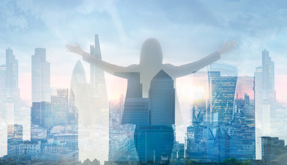 Young woman looking over the City of London at sunset. Future, new business opportunity and business success concept.