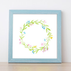 Watercolor flower wreath in gray vintage wooden frame with copy space for text, greeting card background