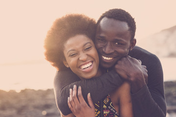 beautiful black race nice model couple man and woman young age hug and stay together with love and...
