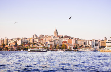 Cityscape of Galata (modern Karakoy) with the Galata Tower and Balik Ekmek fish boat shop in Istanbul. Image with copy space.