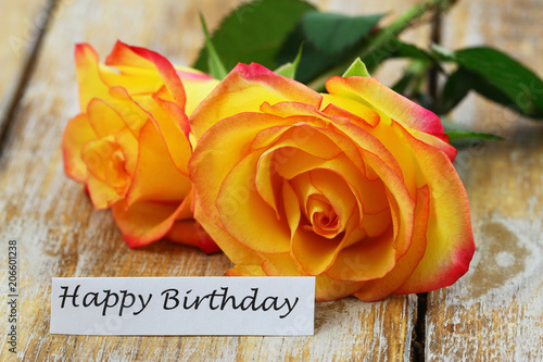 Happy Birthday Card With Two Red And Yellow Roses On Rustic Wooden
