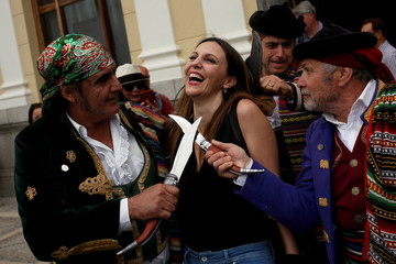 "Men, dressed as bandits, joke with a woman as they participate in the sixth edition of ""Ronda Romantica"" in Ronda"