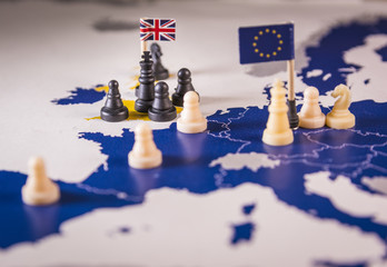 Chess pieces over an european map. Brexit concept