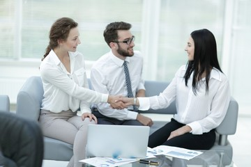 handshake of manager and client in the office lobby
