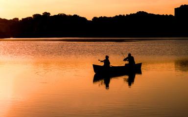 People are enjoying fishing under sunset