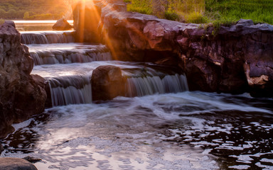 Waterfall under sunset