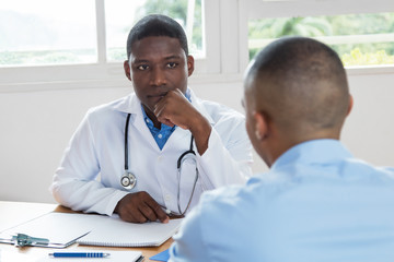 African american doctor listening to problems of patient